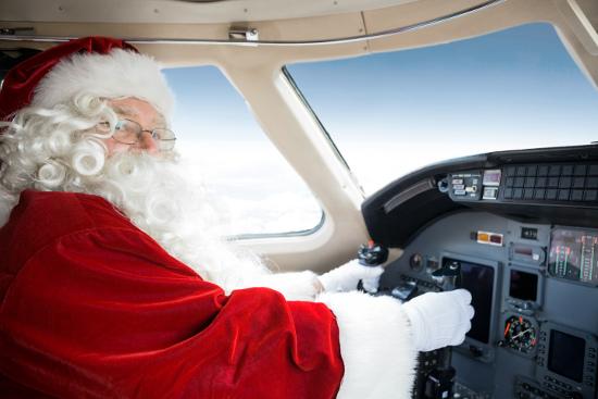 Papa Noel pilotando avión